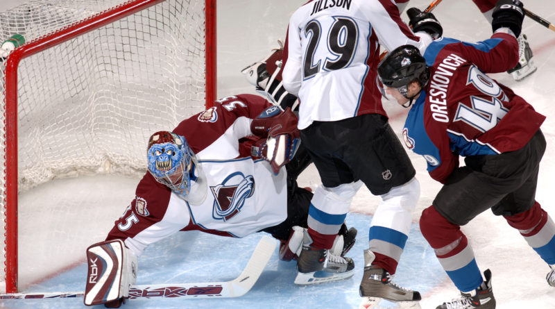 Colorado Avalanche rookie goalie Tyler Weiman slides to make a save in traffic during the Burgundy and White intra-squad scrimmage Sept. 16 at the Cadet Ice Arena at the U.S. Air Force Academy in Colorado Springs, Colo. was the first time an NHL team ever played at the Academy. (U.S. Air Force photo/Dave Armer)